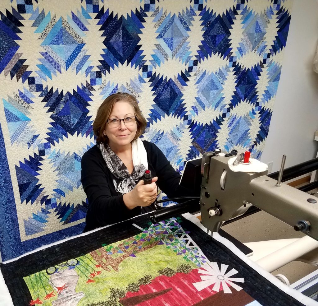 Picture of Marcia in her quilting studio.